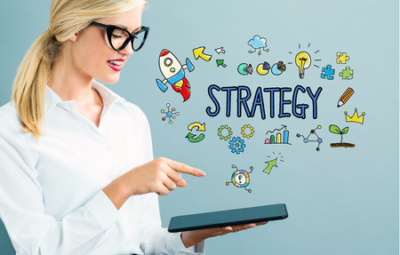 woman tablet: Strategy text with business woman using a tablet