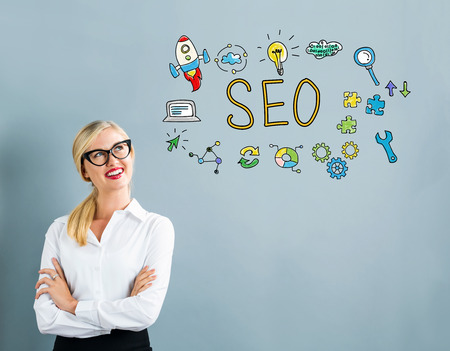 thoughtful: SEO text with business woman on a gray background
