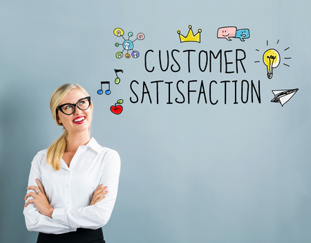 Customer Satisfaction text with business woman on a gray background Stock Photo