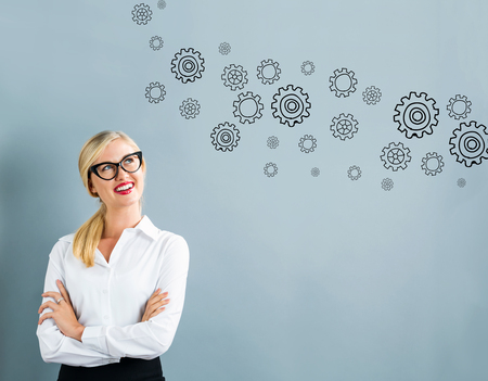 business gears: Gears with business woman on a gray background