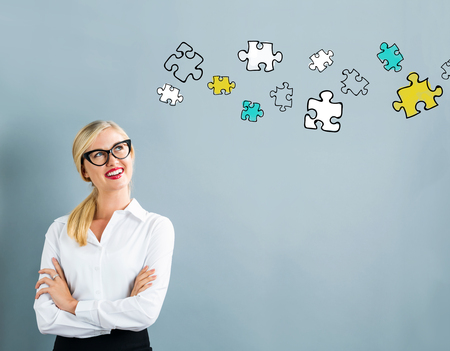 puzzle business: Puzzle drawing with business woman on a gray background Stock Photo