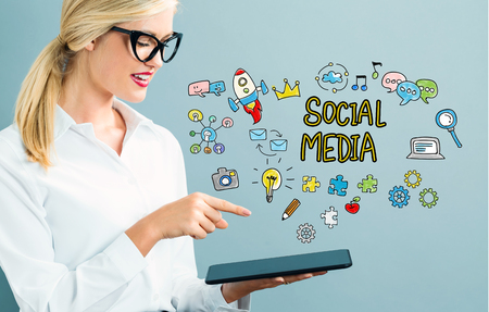 woman tablet: Social Media text with business woman using a tablet Stock Photo
