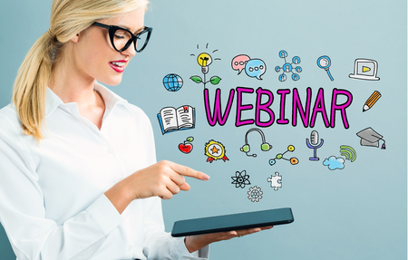 Webinar text with business woman using a tablet