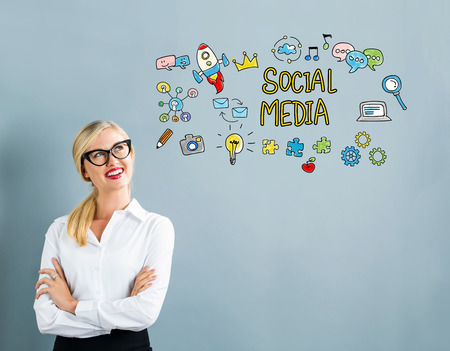 Social Media text with business woman on a gray background Stock Photo