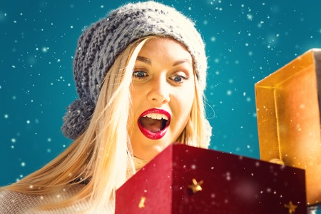 christmas present box: Happy young woman opening a Christmas present box