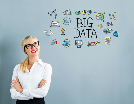 big woman: Big Data text with business woman on a gray background Stock Photo