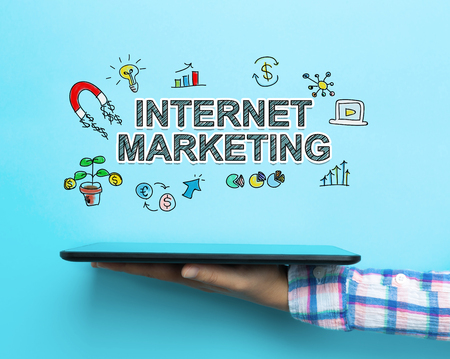 Internet Marketing concept with a tablet on blue background