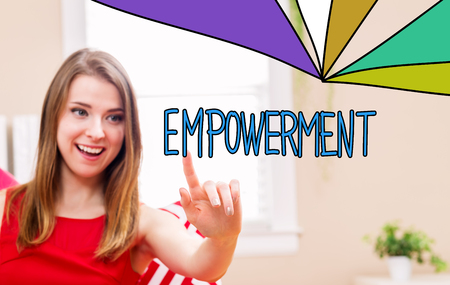 Empowerment concept with young woman in her home