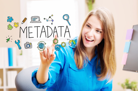 Metadata concept with young woman in her home office Stock Photo