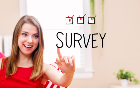 Survey concept with young woman in her home