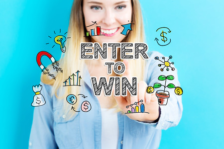 enter: Enter to Win concept with young woman on blue background Stock Photo