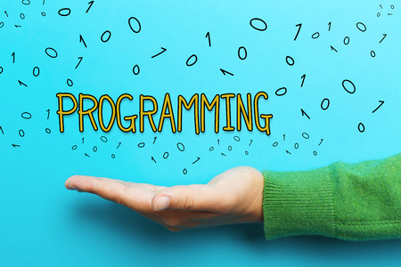 Programming concept with hand on blue background Stock Photo