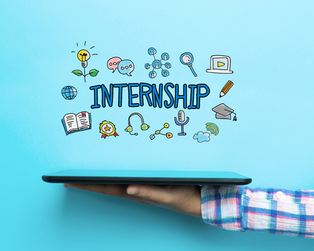 Internship concept with a tablet on blue background