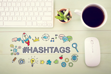 desk light: Hashtags concept with workstation on a light green wooden desk