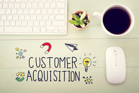 retention: Customer Acquisition concept with workstation on a light green wooden desk