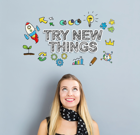 'young things': Try New Things concept with happy young woman on a gray background