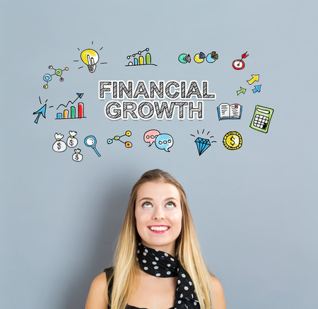 Financial Growth concept with happy young woman on a gray background