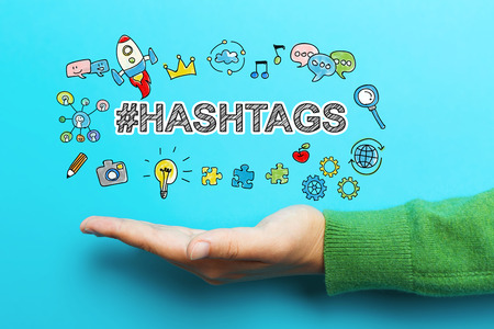 Hashtags concept with hand on blue background Stock Photo