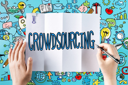 crowd source: Crowdsourcing text with hands and colorful illustrations Stock Photo