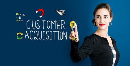 attract: Customer Acquisition concept with business woman on a dark blue background Stock Photo