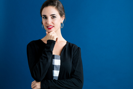 young women: Happy young woman on a blue background