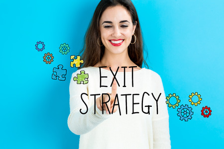 Exit Strategy text with young woman on a blue background Stock Photo