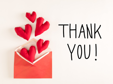 Thank You message with red heart cushions coming out of an envelope Stok Fotoğraf