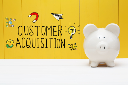 Customer Acquisition text with piggy bank over yellow wall