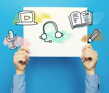 E-Learning on white poster on a blue background