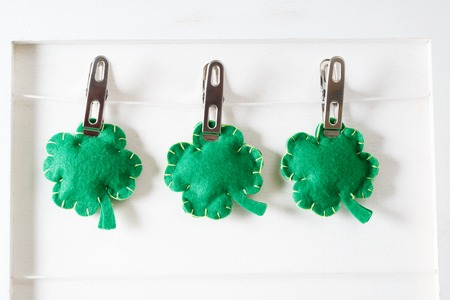 Saint Patricks Day clover cushions hanging with clothespins