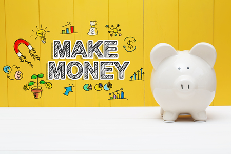 Make Money text with piggy bank over yellow wall