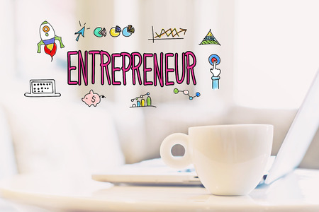 Entrepreneur concept with a cup of coffee and a laptop