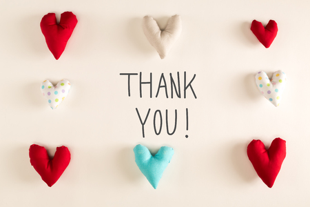 Thank You message with blue heart cushions on a white paper background Stok Fotoğraf - 73126278
