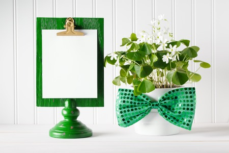 17th: Saint Patricks Day message board with shamrock in white pot