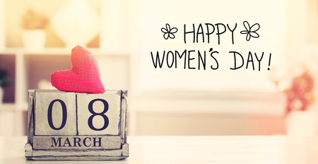 8 March Happy Womens Day message with wooden block calendar Stock Photo