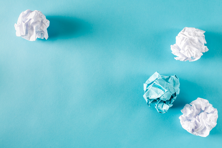 scrunch: Crumpled paper balls on a blue background