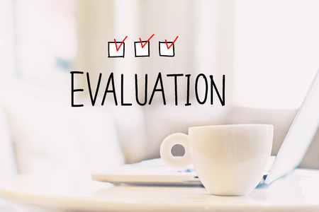 Evaluation concept with a cup of coffee and a laptop