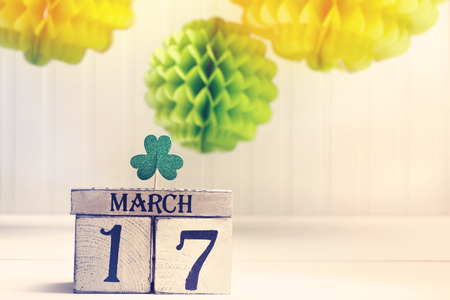 Saint Patricks Day green clover with wooden block calendar Stock Photo