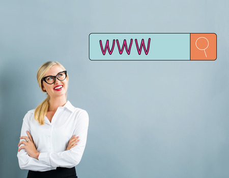 WWW text with business woman on a gray background Stock Photo