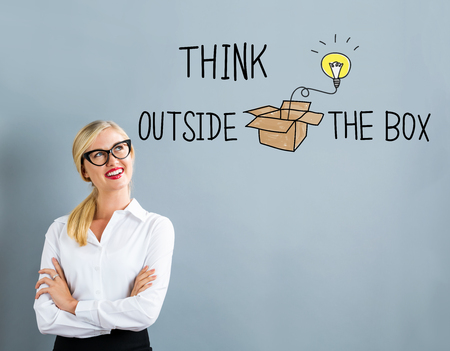 Think Outside The Box text with business woman on a gray background