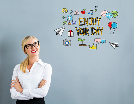 Enjoy Your Day text with business woman on a gray background Stock Photo