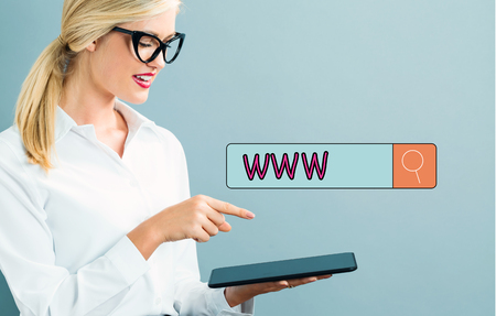 woman tablet: WWW text with business woman using a tablet Stock Photo