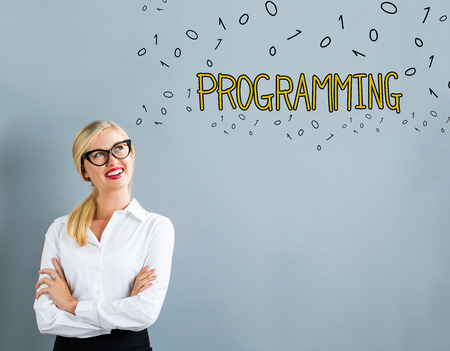 Programming text with business woman on a gray background