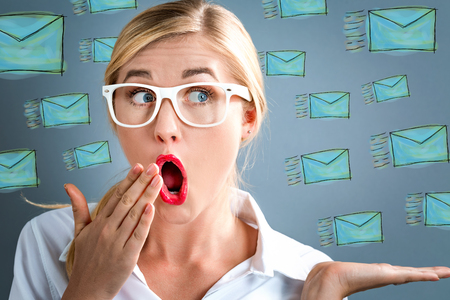 Surprised young business woman with many emails Stock Photo