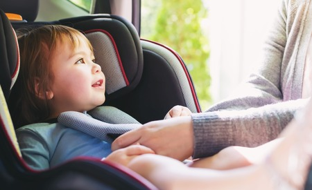 Toddler girl buckled into her car seat Reklamní fotografie - 73961759