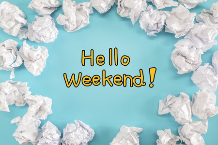 scrunch: Hello Weekend text with crumpled paper balls on a blue background