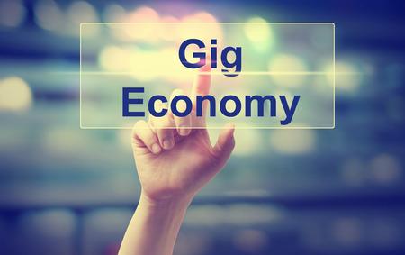 Gig Economy concept with hand pressing a button Banco de Imagens - 73973604