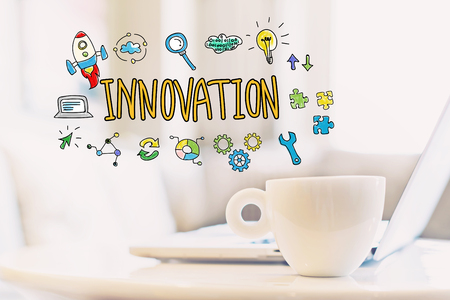 Innovation concept with a cup of coffee and a laptop