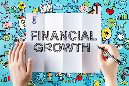 economics: Financial Growth text with hands and colorful illustrations Stock Photo