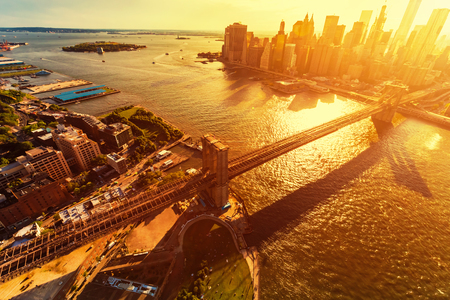Aerial view of the Brooklyn Bridge over the East River in New York City at sunset Stock Photo
